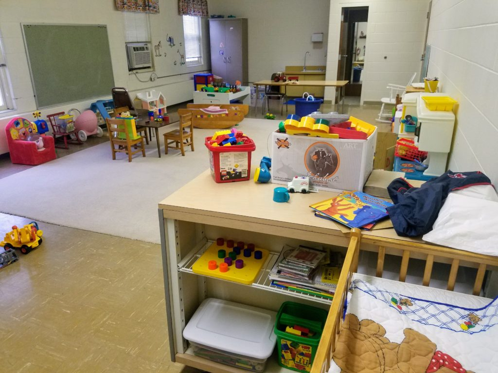 The church nursery, with toys and small table and chairs and windows.